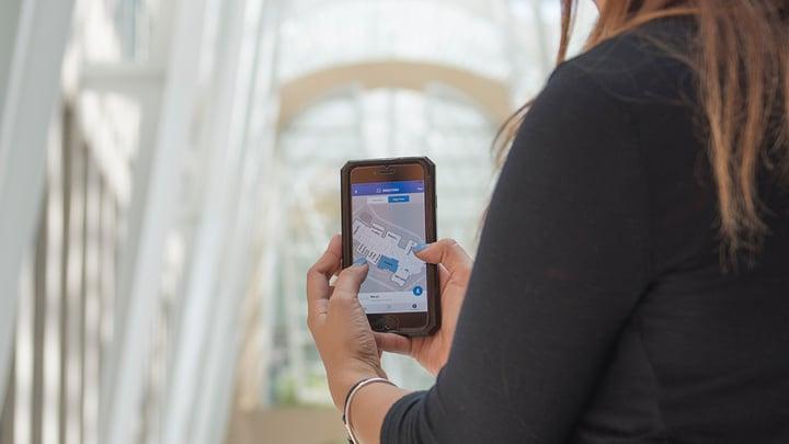 Woman using phone to navigate